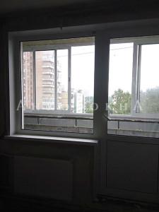 остекление лоджии раздвижными окнами - фото