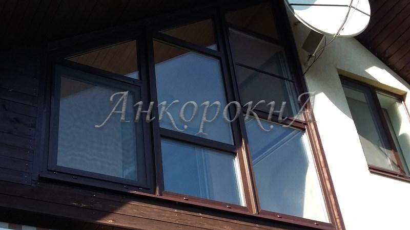 фото остекления дома треугольным окном